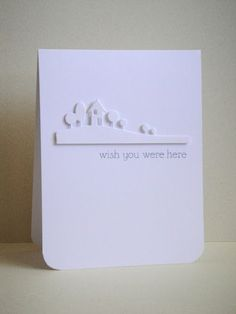 three umbrellas: wish you were here (love the white on white)