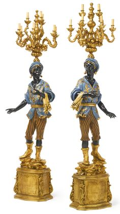 A pair of Venetian giltwood, ebonized and bleu du roi-decorated nine-light blackamoor torchères late 19th/early 20th century Estimate  15,000 — 20,000  USD  LOT SOLD. 17,500 USD