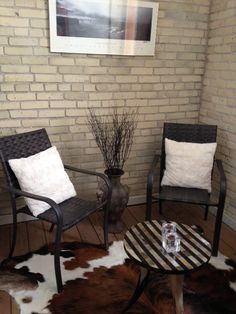 Small cleaner lined chairs for small patio.. W little table and rug it's perfect