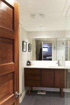 repurpose old teck dresser as bathroom cabinet