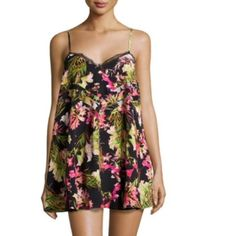 Lovers + Friends Lace Print Tropical Mini dress Floral printed mini dress with lace trim. Really flattering and comfy mini spaghetti dress. Back tie to help fasten the dress. Adjustable shoulder straps. Lovers + Friends Dresses Mini