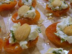 Dried apricot, a sprinkle of basil, goat cheese, a marcona almond, and a drizzle of honey.