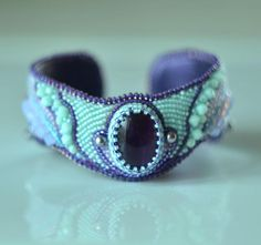 bead embroidery bracelet bedwork jewelry amethyst bracelet cuff bungle bracelet Art Nouveay jewelry set of jewelry beaded bracelet Suzidesign bracelet made in the art of beadwork.embroidered Japanese Toho beads, Natural ametyst, Swarovski elements. they are very flexible-the bracelet has a metal cuff inside Pleace look at this necklace- https://www.etsy.com/listing/505315296/beaded-embroidery-necklace-art-nouveau?ref=shop_home_active_8 you can use this bracelet ...