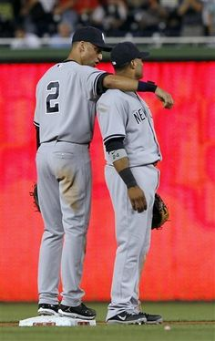 GAME 63: Friday, June 15, 2012 - New York Yankees shortstop Derek Jeter (2) and second baseman Robinson Cano stand together after a baseball game against the Washington Nationals at Nationals Park in Washington. The Yankees won 7-2. (AP Photo/Alex Brandon)