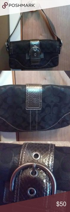 Small silver and black canvas coach bag Snap closure. Very cute. Only used a couple times. Bought at a consignment shop. Coach Bags Shoulder Bags