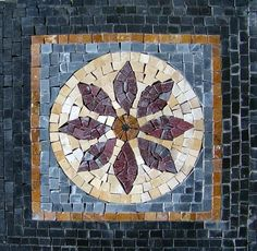 Stone Accent Mosaic With a Floral Mosaic Design Fully Handmade Of Natural Stones And Hand-Cut Tiles. Mosaic Uses: Floors Walls or Tabletops both Indoor or Outdoor as well as wet places such as showers and Pools.
