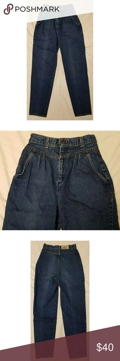 """Vintage 80s Levis Plowboy Mom Jeans 7 Womens vintage 80s Levis mom jeans, size 7. These jeans have the high waist, pleated front, tapered leg, the works! They are in excellent used condition with no stains, tears, rips or holes that I can see.  Waist: 24"""" Inseam: 28.5"""" Outseam: 39"""" Front rise: 12.5"""" Back rise: 15.5"""" Hips: 37"""" Leg opening: 12""""  All items come from a smoke and pet free home. Levi's Jeans"""