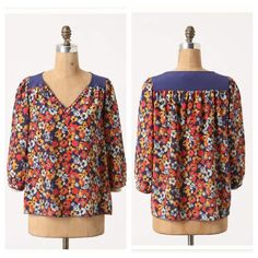 Anthropologie Billion Petals Pullover Brilliantly colored floral pullover top by Porridge. Very light and 100% sold. Adorable buttons at neckline. In excellent used condition! Anthropologie Tops