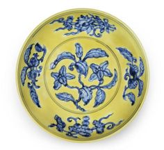 A rare underglaze-blue yellow-ground 'gardenia' saucer dish Zhengde six-character mark and of the period. 明正德 黃地青花折枝花果紋盤 青花「大明正德年製」楷書款
