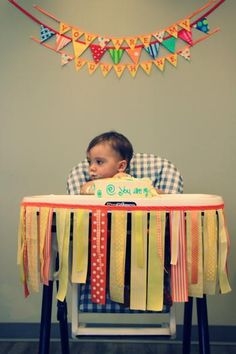 I love the streamers/ribbons to decorate the highchair! # first birthday