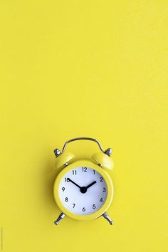 Yellow alarm clock by Ruth Black - Clock, Alarm clock - Stocksy United Clock Wallpaper, Phone Screen Wallpaper, Mood Wallpaper, Wallpaper Backgrounds, Pastel Wallpaper, Wallpaper Quotes, Yellow Clocks, Black Clocks, Yellow Aesthetic Pastel