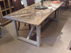 parquet top dining table (87'long), from mecox