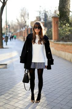 Work Outfit Ideas to Try This Winter - chic white sweater worn with a gray mini skirt + sheer tights and leopard print heels