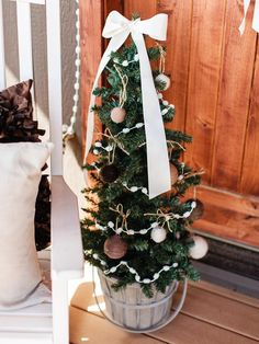 Mini Christmas Tree  - 8 Easy Front Porch Holiday Decorating Ideas  on HGTV