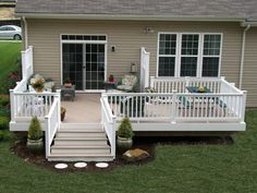 HNH Deck and Porch vinyl deck with Azek brownstone flooring and Longevity white railing.