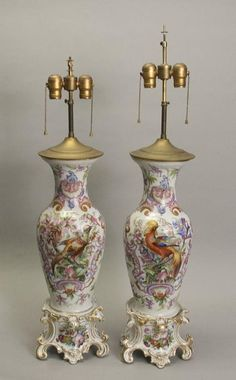 "Pair of finely painted old Paris vases made into lamps.  Decorated with birds and flowers. CIRCA: 1880's DIMENSIONS: 24"" h x 8"" w x 6.5"" d"