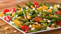Green Bean with sweet tomatoes and grilled corn! Great side dish for barbecued meat, poultry and fish!
