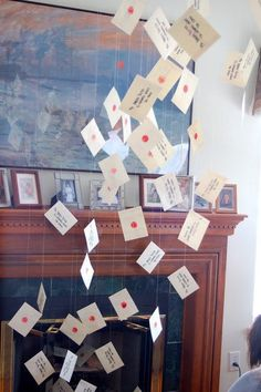 """Add a bit of decor by having letters """"fly"""" out of the fire place."""