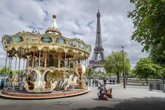 The famous carousel outside the Eiffel Tower in #Paris http://www.nyhabitat.com/blog/2015/03/16/apartments-family-vacation-paris/