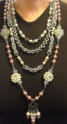 This shabby chic statement necklace was made using repurposed vintage jewelry that belonged to my grandmother. Pendants and focal components are made from her crystal and glass pearl earrings and main pendant is fashioned from an old filigree earring and glass, pearls and crystals. Two of the chains make use of medieval and contemporary chainmaille techniques.