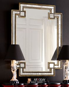 "Mosaic Mirror - Horchow The glamour is all in the geometric, mirrored tile insets framed by a silvery and gold-leaf finished border on this handcrafted mirror. 35""W x 2""D x 49""T. Boxed weight, approximately 63 lbs."