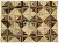 """Log Cabin Quilt - Cowan's Auctions.  American, 19th c., multi-colored fabrics in light and dark """"Log Cabin"""" pattern with pink backing, 71"""" x 51.25""""."""
