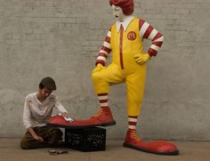 Banksy: better out than in NYC street art - part two - a shoe shine boy in the Bronx