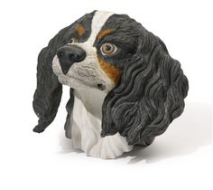 A Russian porcelain figural wall decoration, Gardner Porcelain Manufactory, Verbilki, 1880s -    modeled as the head of a hunting dog, with stamped and impressed manufactory marks, also with impressed 6, possibly a model number height 7 1/2 in. (19.1 cm)