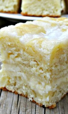 Cream Cheese Coffee Cake Recipe ~ moist and buttery, with a cheesecake like swirl in the middle, some texture from the streusel and sweetness from the powdered sugar glaze