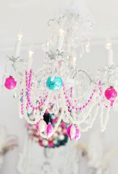Holiday ornaments on chandelier