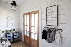 Farmhouse Entry by Magnolia Homes - love this sign - Typographic art:  pick a quote that has meaning for you and turn it into art in a snap by stamping, painting or simply printing out the words. Place your creation in a rustic wooden frame for a handmade look.
