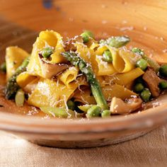 Homemade Pappardelle Pasta with Mushrooms, Green Peas, and Asparagus | MyRecipes.com