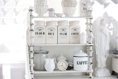 White and Shabby - Use chalk paint to refinish an old shelf and place your canisters on it. Great idea!