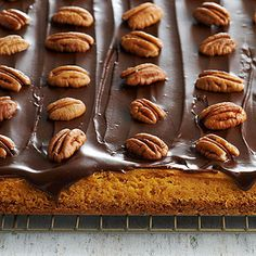 Pumpkin Cheesecake Bars with Chocolate Topping : Oatmeal cookie mix and canned pumpkin provide the base of these over-the-top bars that feature a luscious chocolate-pecan topping