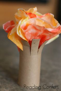 Fall tree craft for kids made from an empty cardboard tube and coffee filters and a great fall book