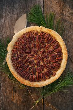 Holiday pecan pie on wood background.