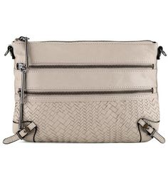 Truffle, a stylish new shade of neutral, is the perfect color to transition beautifully into fall. Versatile and elegant, the Bali 89  3 zip clutch is perfectly sized for every day and every occasion.