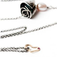 Black Rose Necklace by Larissa Landinez  18kt yellow gold, ruby (1 pt), 925 sterling silver, cultured pearl, Iolite stone