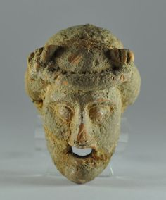 Greek theater mask, 4th century B.C. Greek terracotta theater mask, due the small dimension is a Greek votive theater mask, 6.9 cm long. Private collection