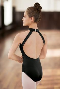 The conservative, high-neck front of this halterneck leotard is off-set by a dramatic, low open back.