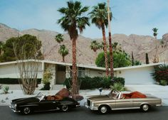 Not only do I love the mid century modern house but my dad had a Mercedes 190 SL like the black one when I was growing up.