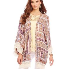 Democracy geometric fringe caftan Soft flowy rayon caftan features a geometric- print in shades of orange-purple-gold and white trimmed with a beige cotton fringe, 3/4 sleeves...front pockets Democracy Jackets & Coats Capes