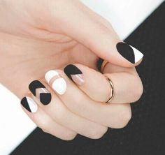 Black and white negative space nail art designs.