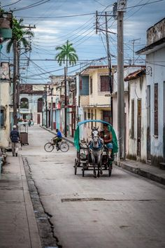 "10 Tips for Photographing Your Trip to Cuba: Some of the best travel images are captured while in transit. Keeping your camera on the ready while you're in a car, train or bike taxi is the perfect opportunity to capture the local culture in an unobtrusive way. In Cuba, you'll find horse-drawn carriages still in use. ""The clip-clopping sound of horse and cart taxis seems to echo in the sleepy streets of Santa Clara,"" says photographer Jillian Mitchell."