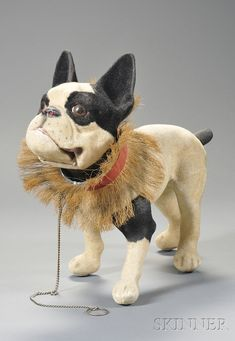 FLOCKED PAPIER-MACHE FRENCH BULLDOG PULL-TOY, EARLY 20TH CENTURY, NODDING HEAD WITH GLASS EYES, THE CHAIN LEASH PULL OPENS HINGED MOUTH - AMERICAN FURNITURE & DECORATIVE ARTS - SALE 2558M - LOT 856 - Skinner Inc