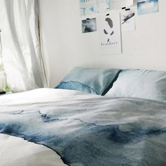 Guest bedroom decor simplified: Aquarelle-printed summer sheets (and matching art) evocative of the sea and the land from a new Amsterdam bedding company.