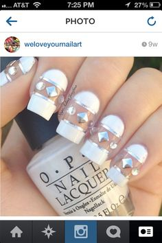 White nails with negative space and silver studs