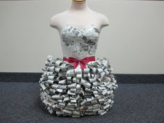 Dress made with paper mache, newspaper, and ribbon. Recycle and redecorate project?