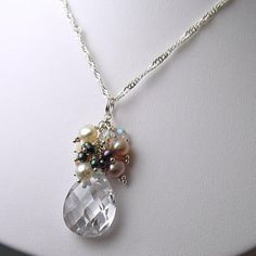 different colored pearls with a statement crystal