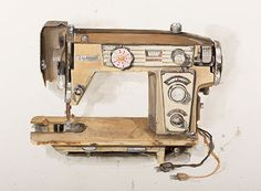 A photograph of a drawing of a brown sewing machine by KJ James